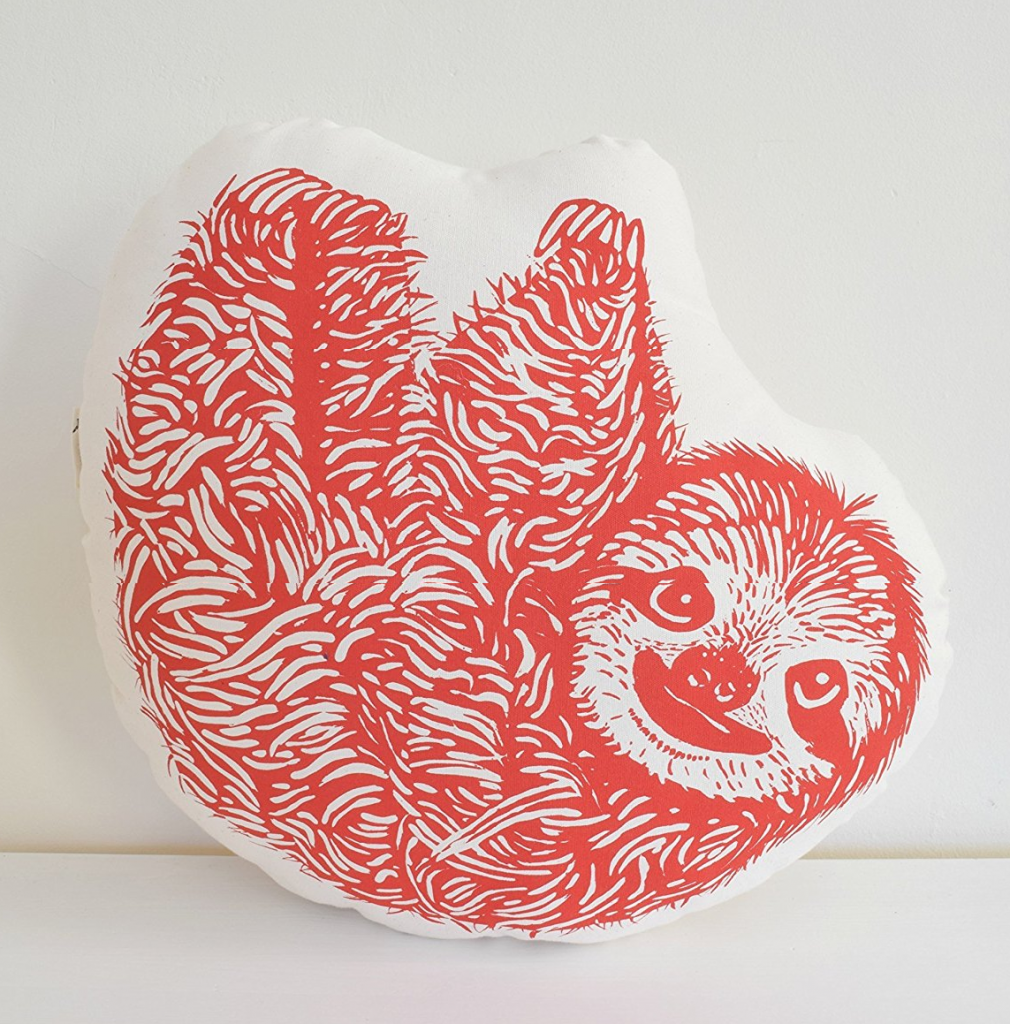 Large red sloth decorative pillow.